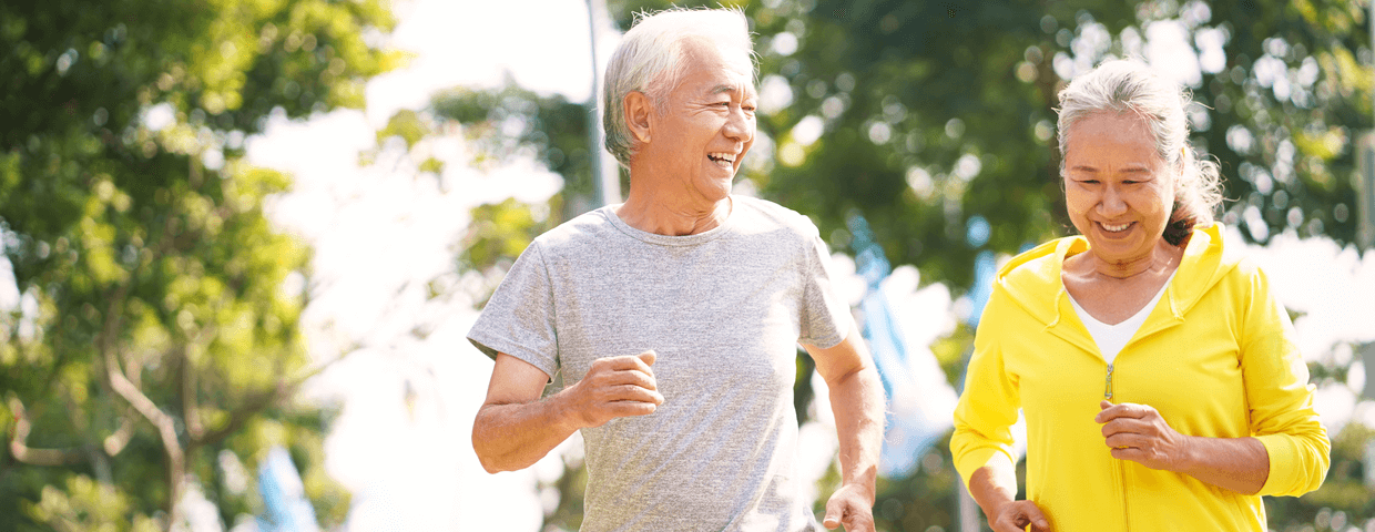 happy asian senior couple running exercising outdoors in park, exercise for heart health