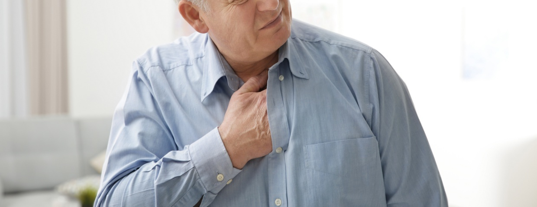 man having sternum pain