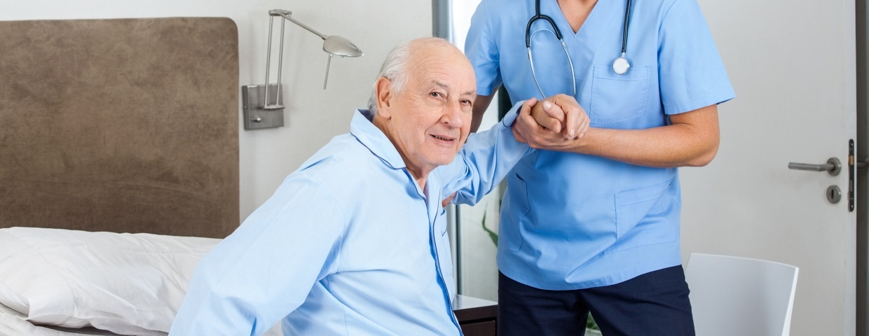 old man supported by nurse