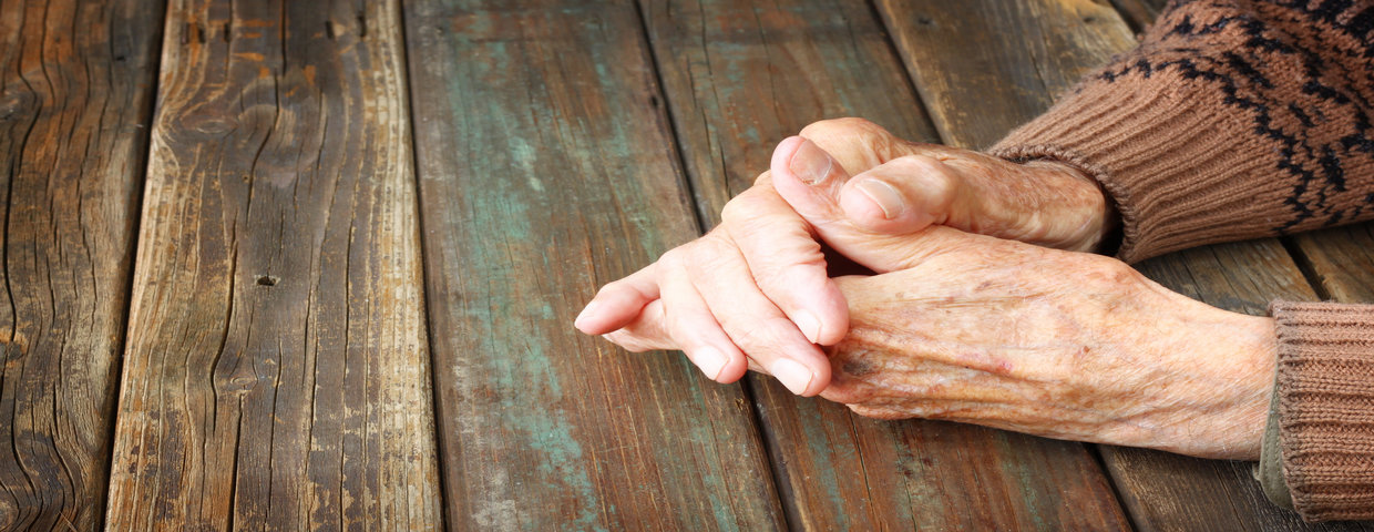 old womans resting hands