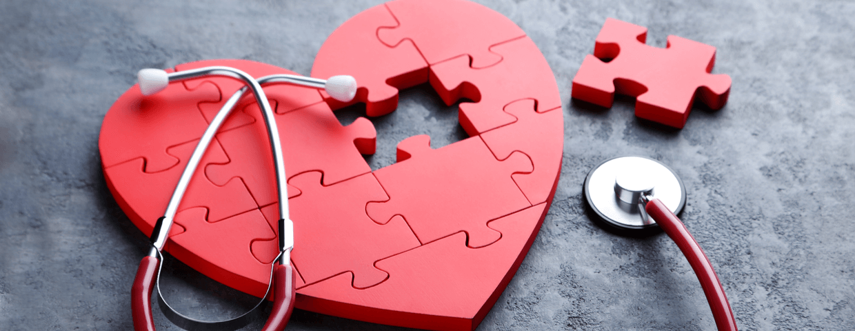 Red puzzle heart with stethoscope, heart surgery and recovery concept