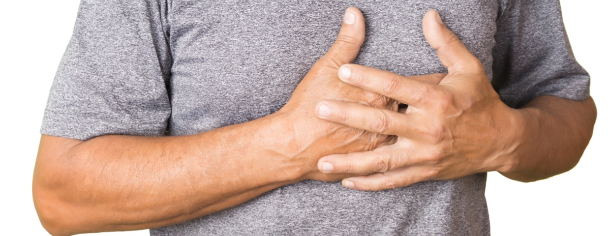 man gripping chest in pain